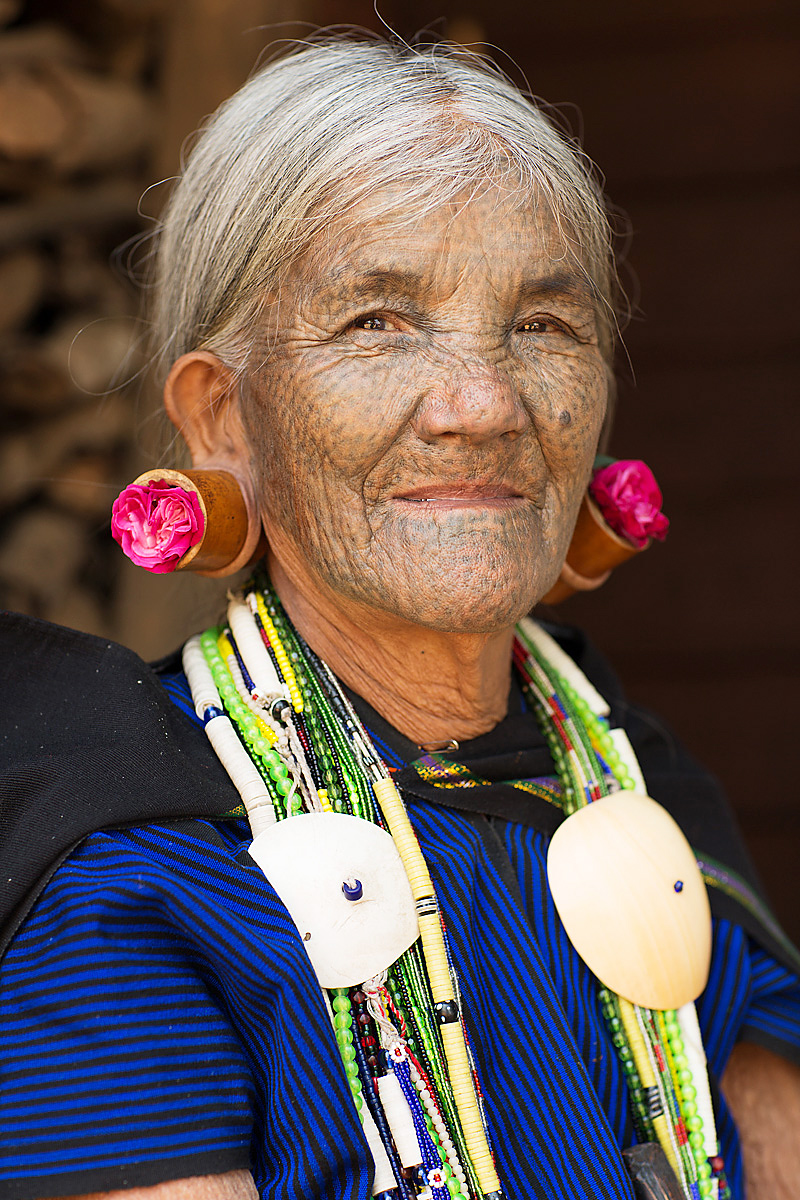 Nose Flute Woman Mindat Myanmar by Dave White while in Burma