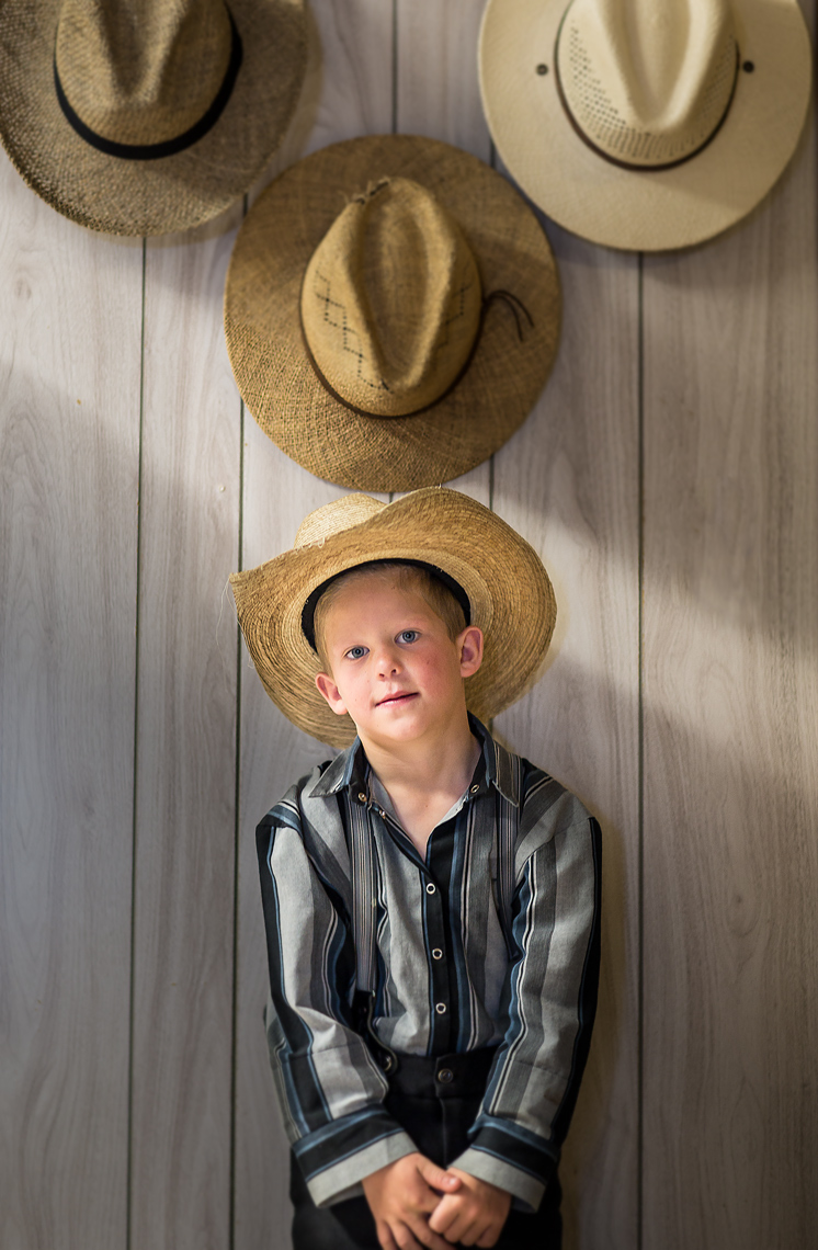 Hutterite-Boy-and-Hats.jpg